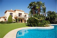Swimming pool and Spanish villa Stock Photo - Premium Royalty-Freenull, Code: 6113-06498363