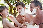 Playful multi-generation men applying shaving cream to faces Stock Photo - Premium Royalty-Free, Artist: I Dream Stock, Code: 6113-06498565