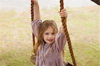 swing (sports) - Portrait of smiling girl on swing Stock Photo - Premium Royalty-Freenull, Code: 6113-06498585