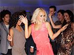 Friends dancing at nightclub Stock Photo - Premium Royalty-Free, Artist: Blend Images, Code: 6113-06498601