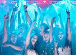 Portrait of enthusiastic crowd with arms raised at concert Stock Photo - Premium Royalty-Free, Artist: Blend Images, Code: 6113-06498631