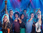Portrait of enthusiastic crowd on dance floor of nightclub Stock Photo - Premium Royalty-Free, Artist: Blend Images, Code: 6113-06498637