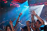 Enthusiastic crowd with arms raised on dance floor of nightclub Stock Photo - Premium Royalty-Free, Artist: ableimages, Code: 6113-06498643