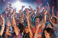 Enthusiastic crowd cheering at concert Stock Photo - Premium Royalty-Freenull, Code: 6113-06498665