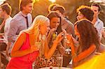 Smiling women drinking cocktails on sunny balcony Stock Photo - Premium Royalty-Free, Artist: Strauss/Curtis, Code: 6113-06498673