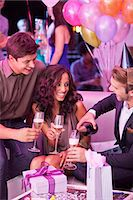 Smiling friends drinking champagne and celebrating birthday in nightclub Stock Photo - Premium Royalty-Freenull, Code: 6113-06498688