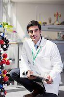 Portrait of smiling scientist in laboratory Stock Photo - Premium Royalty-Freenull, Code: 6113-06498859