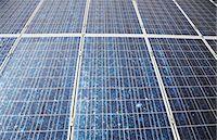 solar power - Sun shining on solar panels Stock Photo - Premium Royalty-Freenull, Code: 6113-06498873