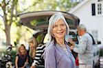 Older woman smiling outdoors Stock Photo - Premium Royalty-Free, Artist: Uwe Umsttter, Code: 6113-06498970