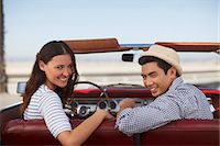 road trip - Smiling couple sitting in convertible Stock Photo - Premium Royalty-Freenull, Code: 6113-06498984