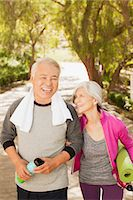 Older couple walking together outdoors Stock Photo - Premium Royalty-Freenull, Code: 6113-06499023