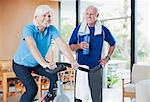 Older woman riding exercise bike at home Stock Photo - Premium Royalty-Free, Artist: CulturaRM, Code: 6113-06499045