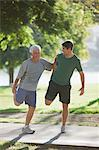 Older man stretching with trainer Stock Photo - Premium Royalty-Free, Artist: CulturaRM, Code: 6113-06499051