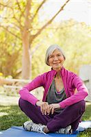 Older woman sitting on yoga mat outdoors Stock Photo - Premium Royalty-Freenull, Code: 6113-06499117