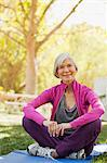 Older woman sitting on yoga mat outdoors Stock Photo - Premium Royalty-Free, Artist: Ikon Images, Code: 6113-06499117