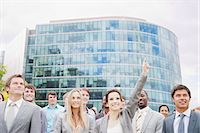 Crowd of smiling business people in front of building Stock Photo - Premium Royalty-Freenull, Code: 6113-06499159