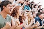 Fans cheering in crowd Stock Photo - Premium Royalty-Free, Artist: Blend Images, Code: 6113-06499162