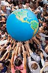 Crowd of people reaching for globe Stock Photo - Premium Royalty-Free, Artist: CulturaRM, Code: 6113-06499192