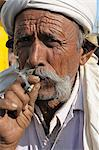 Smoking beedies by men in rural India, Gujarat, India, Asia Stock Photo - Premium Rights-Managed, Artist: Robert Harding Images, Code: 841-06499799