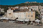 Pavement cafes in the main square overlooked by the ancient fortress, in the medieval city of Hvar, island of Hvar, Dalmatia, Croatia, Europe Stock Photo - Premium Rights-Managed, Artist: Robert Harding Images, Code: 841-06500336