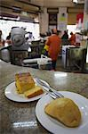 Sopa paraguaya (cornbread with cheese and onion) and empanada in Lido Bar, Asuncion, Paraguay, South America Stock Photo - Premium Rights-Managed, Artist: Robert Harding Images, Code: 841-06501877