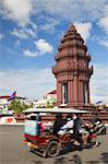 Tuk tuk passing Independence Monument, Phnom Penh, Cambodia, Indochina, Southeast Asia, Asia Stock Photo - Premium Rights-Managed, Artist: Robert Harding Images, Code: 841-06501895