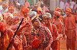 Barsana villagers celebrating Holi in Nandgaon, taunting Nandgaon villagers who throw colored fluids over them, Nandgaon, Uttar Pradesh, India, Asia Stock Photo - Premium Rights-Managed, Artist: Robert Harding Images, Code: 841-06502144