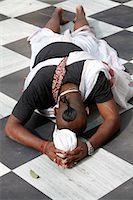 Hare Krishna devotee prostrating on the temple floor, Vrindavan, Uttar Pradesh, India, Asia Stock Photo - Premium Rights-Managednull, Code: 841-06502173