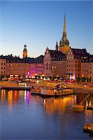 stockholm - Gamla Stan and Riddarholmen with spire of Riddarholmskyrkan (Riddarholmen Church) at dusk, Stockholm, Sweden, Scandinavia, Europe Stock Photo - Premium Rights-Managednull, Code: 841-06502886