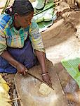 Lady chopping false banana Chencha, Dorze, Ethiopia, Africa Stock Photo - Premium Rights-Managed, Artist: Robert Harding Images, Code: 841-06503319