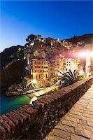 Clifftop village of Riomaggiore at dusk, Cinque Terre National Park, UNESCO World Heritage Site, Liguria, Italy Stock Photo - Premium Rights-Managednull, Code: 700-06512758