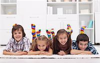 stocking feet - Children laying on the floor wearing colorful socks Stock Photo - Royalty-Freenull, Code: 400-06520115