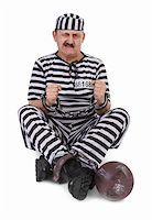 prisoner is struggling with handcuffs over white background Stock Photo - Royalty-Freenull, Code: 400-06521889