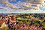 View on red tiled roofs of small town among hills and meadows under beautiful sky at sunset in autumn in Piedmont, Italy. Stock Photo - Royalty-Free, Artist: rglinsky                      , Code: 400-06521923