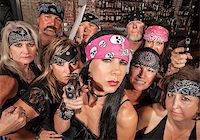 Threatening motorcycle gang members with gun and knife Stock Photo - Royalty-Freenull, Code: 400-06522838