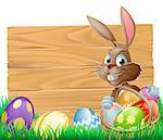 The Easter bunny with a basket of Easter eggs with more Easter eggs around him by a wood sign board Stock Photo - Royalty-Free, Artist: Krisdog                       , Code: 400-06526884