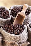 Roasted coffee beans in burlap sacks - closeup Stock Photo - Royalty-Free, Artist: lightkeeper                   , Code: 400-06526958