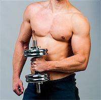 attractive athletic male torso with dumbbells in hand Stock Photo - Royalty-Freenull, Code: 400-06530357