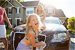 A family washes their car in the driveway of their home on a sunny summer afternoon in Portland, Oregon, USA Stock Photo - Premium Royalty-Free, Artist: Ty Milford, Code: 600-06531429