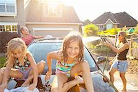 preteen bathing suit - A family washes their car in the driveway of their home on a sunny summer afternoon in Portland, Oregon, USA Stock Photo - Premium Royalty-Freenull, Code: 600-06531431