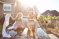 preteen bathing suit - A family washes their car in the driveway of their home on a sunny summer afternoon in Portland, Oregon, USA Stock Photo - Premium Royalty-Freenull, Code: 600-06531432