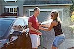 Couple washing their car in the driveway of their home on a sunny summer afternoon in Portland, Oregon, USA Stock Photo - Premium Royalty-Free, Artist: Ty Milford, Code: 600-06531433