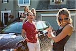 A family washes their car in the driveway of their home on a sunny summer afternoon in Portland, Oregon, USA Stock Photo - Premium Royalty-Free, Artist: Ty Milford, Code: 600-06531436