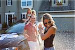 A family washes their car in the driveway of their home on a sunny summer afternoon in Portland, Oregon, USA Stock Photo - Premium Royalty-Free, Artist: Ty Milford, Code: 600-06531437