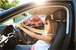 Young girl sitting in driver's seat of car, pretending to be old enough to drive as her smiling father watches on on a sunny summer evening in Portland, Oregon, USA Stock Photo - Premium Royalty-Free, Artist: Ty Milford, Code: 600-06531446