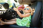 Portrait of little girl sitting in driver's seat of car, pretending to be old enough to drive as her smiling father watches on on a sunny summer evening in Portland, Oregon, USA Stock Photo - Premium Royalty-Free, Artist: Ty Milford, Code: 600-06531449