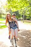 Young couple riding bike together in a park on a warm summer day in Portland, Oregon, USA Stock Photo - Premium Royalty-Free, Artist: Ty Milford, Code: 600-06531451