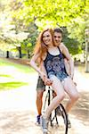 Young couple riding bike together in a park on a warm summer day in Portland, Oregon, USA Stock Photo - Premium Royalty-Free, Artist: Ty Milford, Code: 600-06531452