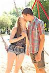 Young couple on swingset in park, kissing on a warm summer day in Portland, Oregon, USA Stock Photo - Premium Royalty-Free, Artist: Ty Milford, Code: 600-06531462
