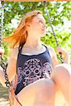 Young Woman on Swing in park on a warm summer day in Portland, Oregon, USA Stock Photo - Premium Royalty-Free, Artist: Ty Milford, Code: 600-06531464